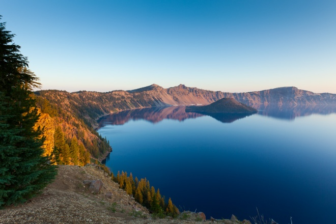 Crater Lake as the sun starts to light up the rim of the caldera, the start of a perfect day to explore the lake