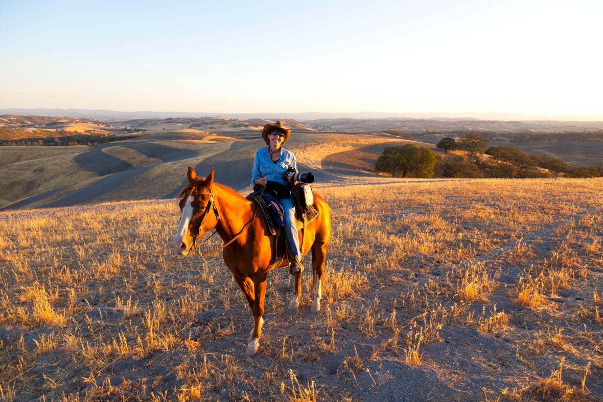 Shooting on horseback at sunset.  I love my job!