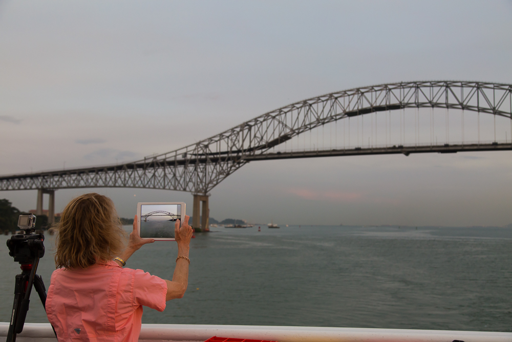 Entering the canal by passing under the Bridge of the Americas near Panama City