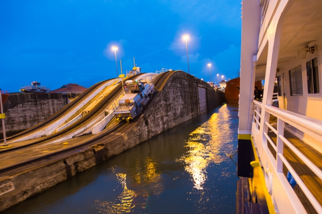 Our ship, the National Geographic Sea Bird, tethered to one of the trains that guide the ship through the canal.