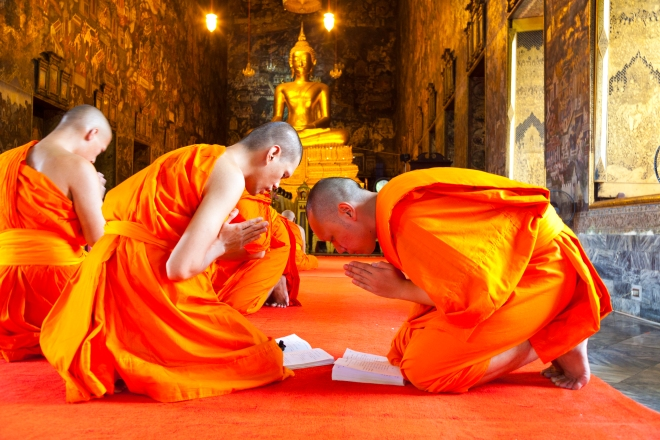 Monks during prayer at Wat Suthat Thepphawararam a royal temple of the first grade, one of ten such temples in Bangkok.