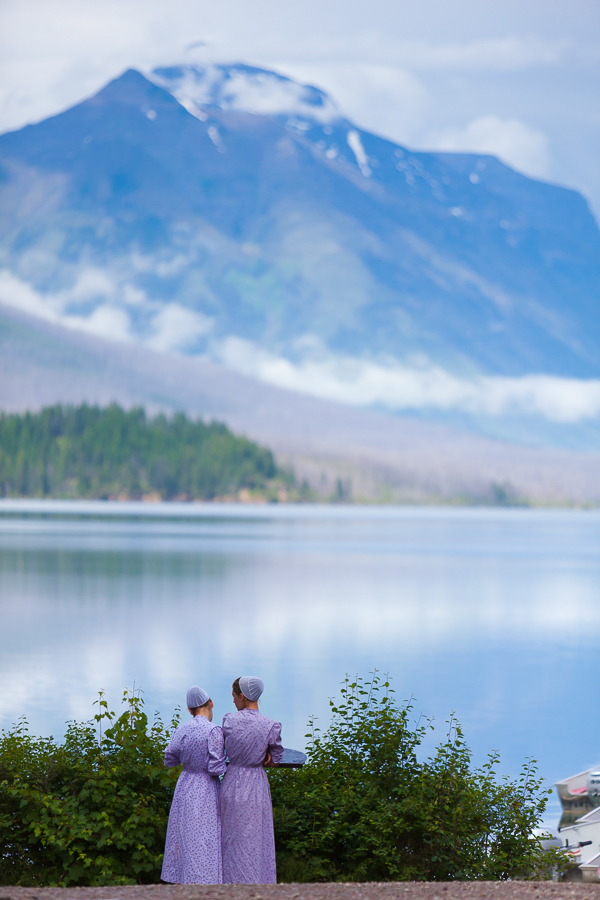 Two Amish women admiring the view of Lake McDonald in Glacier National Park, Montana