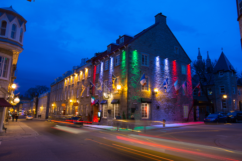 Street scenes from Vieux Quebec, the only fortified city in North America north of Mexico, Quebec City, Canada. Rue Saint Louis lighting up at dusk