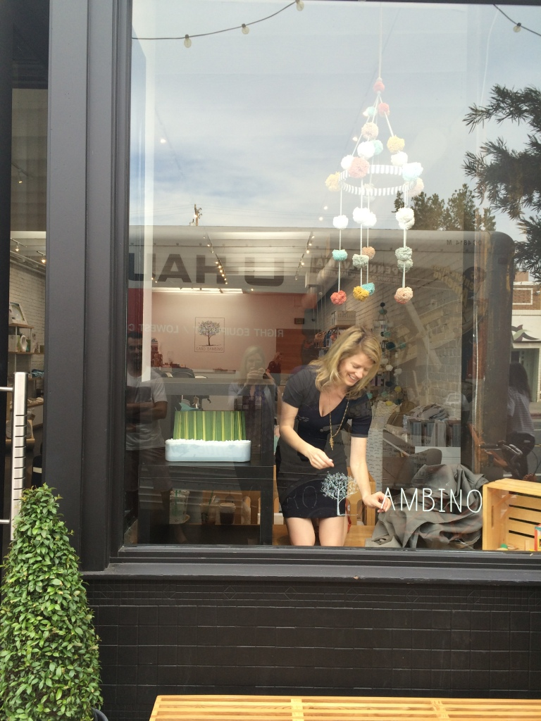 It was all hands on deck to prepare for day one of shooting.  Here I am, removing the logo on the store window.  Susan did the other window!