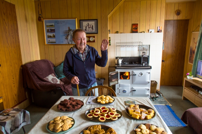 Tea and cakes served by the peat burning oven, Long Island Farm, Falkland Islands