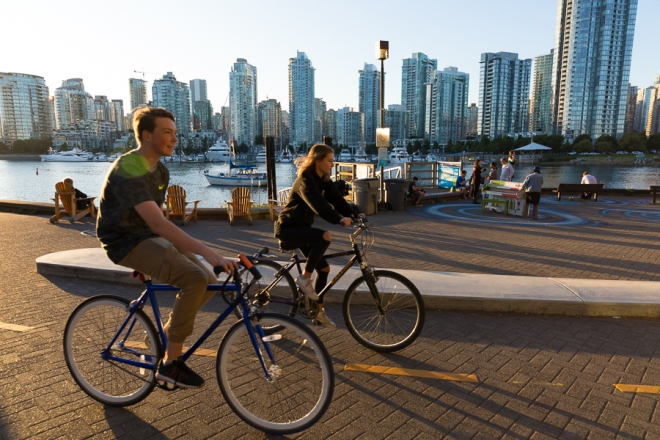 Stamps Landing, an aqua-bus stop in False Creek, Vancouver, British Columbia, Canada, at sunset.  Many locals use this area to sit and watch the sunset on a beautiful day, as well as bike and walk along the seawall.