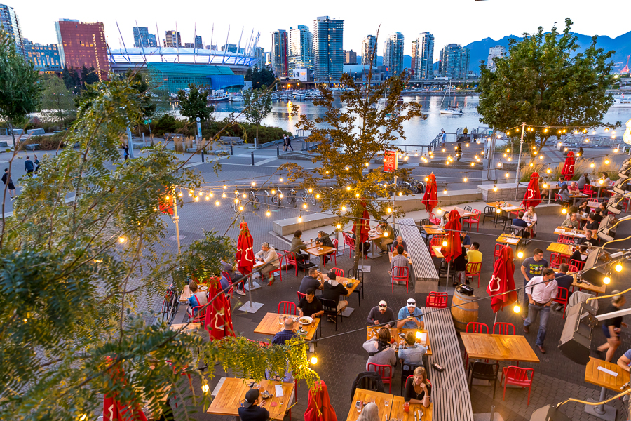 Tap and Barrel Restaurant on a beautiful evening in Olympic Village, Vancouver, British Columbia.  Olympic Village is located on False Creek near the Science Center.  This particular location of Tap and Barrel offers views of False Creek, downtown Vancouv