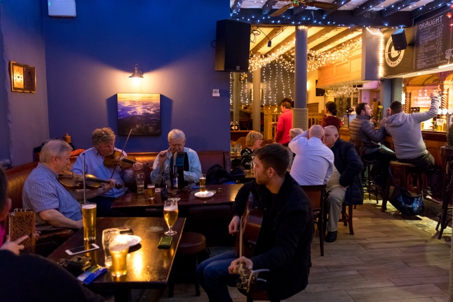 Traditional Irish Music being played by local musicians at the Guildhall Taphouse, located in the Guildhall outside the old walls in Derry, Ireland